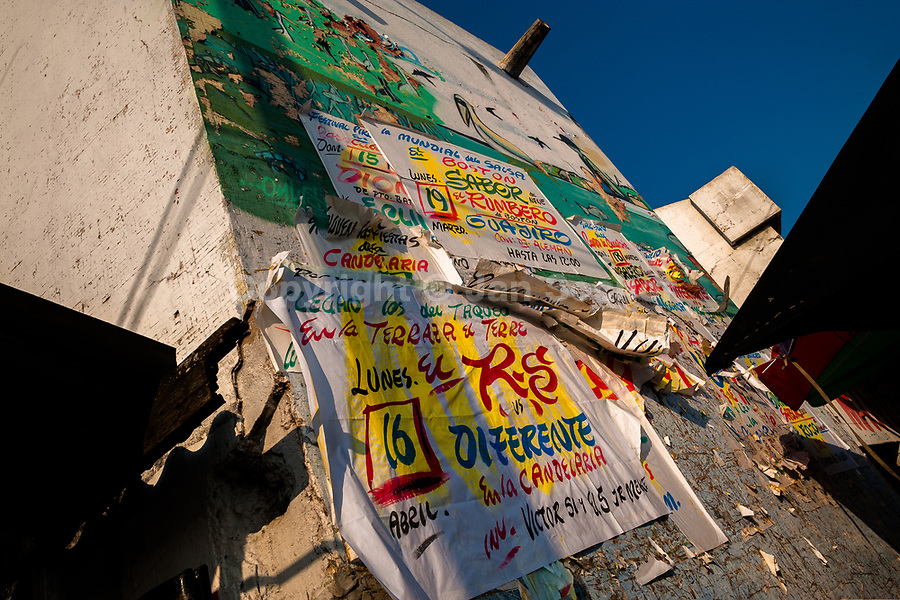 """Champeta music party posters, created by Runner's collective, are seen on the wall in Cartagena, Colombia, 16 April 2018. Hidden in the dark, narrow alleys of Bazurto market, a group of dozen young men gathered around José Corredor (""""Runner""""), the master painter, produce every day hundreds of hand-painted posters. Although the vast majority of the production is designed for a cheap visual promotion of popular Champeta music parties, held every weekend around the city, Runner and his apprentices also create other graphic design artworks, based on brush lettering technique. Using simple brushes and bright paints, the artisanal workshop keeps the traditional sign painting art alive."""