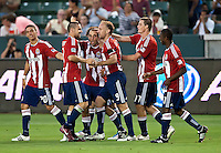 CARSON, CA – July 2, 2011: Chivas USA team celebrating their goal during the match between Chivas USA and Chicago Fire at the Home Depot Center in Carson, California. Final score Chivas USA 1, Chicago Fire 1.
