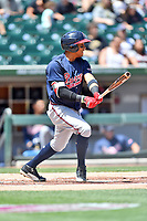 Gwinnett Braves third baseman Johan Camargo (2) swings at a pitch during a game against the Charlotte Knights at BB&T Ballpark on May 7, 2017 in Charlotte, North Carolina. The Knights defeated the Braves 7-1. (Tony Farlow/Four Seam Images)