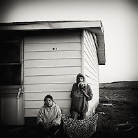 Republic of Lakotah.Pine Ridge Indian Reservation, South Dakota..Pine Ridge is the poorest Indian reservation in the United States. Almost have of it's residents live below the poverty line and unemployment is around 80%. ..Evergreen Public Housing, Porcupine. Fionna Martin (l) and Emerson Never Misses His Shot (r)
