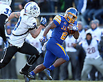 BROOKINGS, SD - NOVEMBER 9:  Isaac Rodriguez #2 from South Dakota State University looks back at Donovan Layne #3 from Indiana State University while scampering for a 45 yard gain Saturday at Coughlin Alumni Stadium. (Photo by Dave Eggen/Inertia)