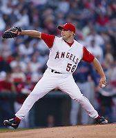 Jarrod Washburn of the Los Angeles Angels pitches during a 2002 MLB season game at Angel Stadium, in Anaheim, California. (Larry Goren/Four Seam Images)