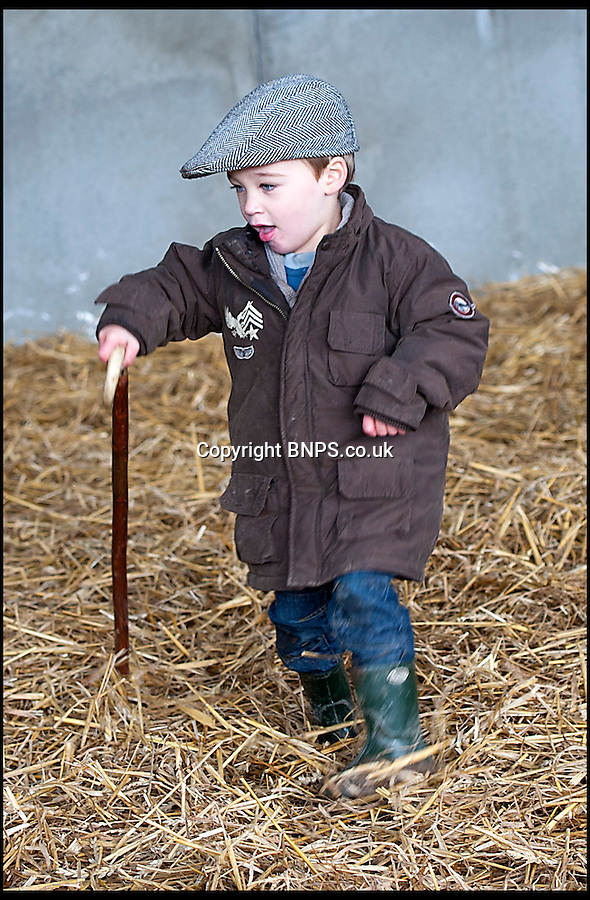 BNPS.co.uk (01202) 558833<br /> Picture: LauraJones/BNPS<br /> <br /> Little Arthur Jones is Britain's youngest shepherd - at just two and a half years old.<br /> <br /> He's not even old enough to go to school but Arthur already looks after his own flock of sheep which he herds himself on a mini quad bike.<br /> <br /> The inspirational toddler has formed a special bond with Twinkle, a lamb which like himself was born prematurely.<br /> <br /> He helped nurse Twinkle back to health, and the pair now are so inseparable that Twinkle comes running when she hears Arthur's voice.<br /> <br /> Arthur suffers from cerebral palsy but has not let the condition come between him and his animals, which he tends to daily at his grandmother's farm.