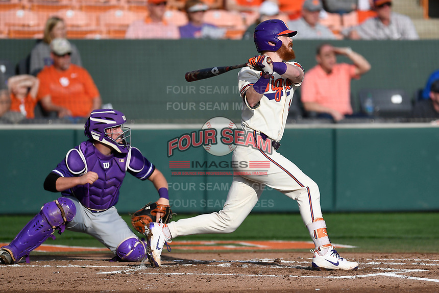 Second baseman Grayson Byrd (4) of the Clemson Tigers bats in a game against the Furman Paladins on Tuesday, February 20, 2018, at Doug Kingsmore Stadium in Clemson, South Carolina. The catcher is Logan Taplett. Clemson won, 12-4. (Tom Priddy/Four Seam Images)