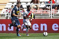 02.09.2012 SPAIN -  La Liga 12/13 Matchday 3rd  match played between Rayo Valelcano vs Sevilla Futbol Club (0-0) at Campo de Vallecas stadium. The picture show Tomas Alberto Boita (Spanish Midfielder of Sevilla F.C.) and Alhassane Bangoura LASS (Guinean striker of Rayo Vallecano)