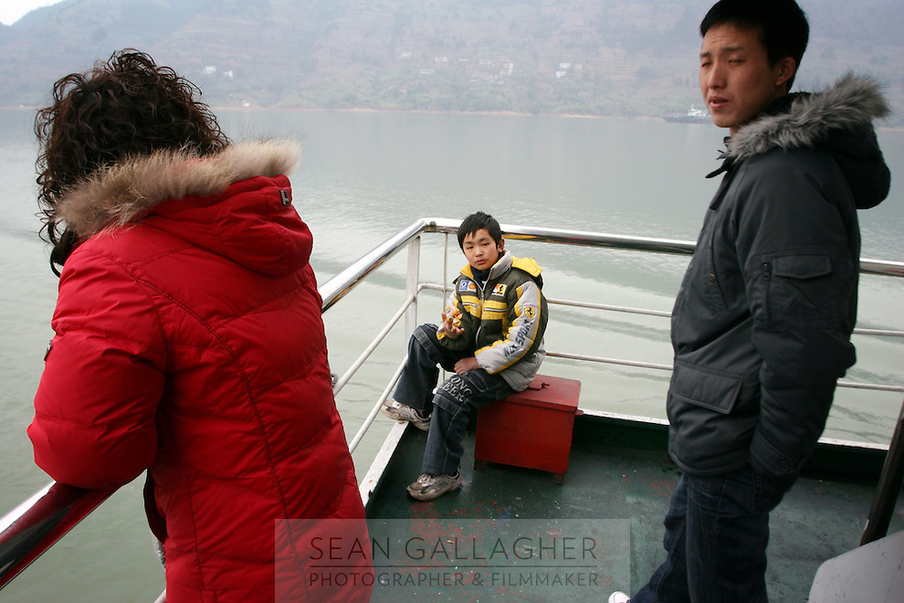 CHINA. Chongqing Province.  Tourists passing though th 3 Gorges. The flooding of the three Gorges, by damming the Yangtze near the town of YiChang, has remained a controversial subject due to the negative environmental consequences and the displacement of millions of people in the flood plain. The Yangtze River however is reported to be at its lowest level in 150 years as a result of a country-wide drought. It is China's longest river and the third longest in the world. Originating in Tibet, the river flows for 3,964 miles (6,380km) through central China into the East China Sea at Shanghai.  2008.