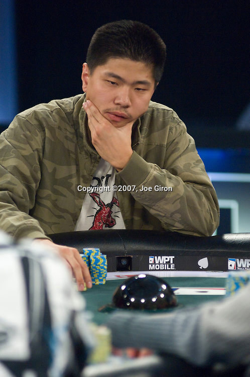 "Shi Jia Liu thinks and then moves ""all in."""