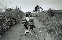 PORT SHEPSTONE, SOUTH AFRICA - JANUARY 29: Unidentified schoolgirls walk home from school January 29, 2002 in Murhison, a rural area outside Port Shepstone, in Southern Natal Province, in South Africa. Approximately 35 percent of rapes of children in South Africa occur in schools or when children are on their way to school, according to a recent study in South Africa. These crimes against children are often done by people they trust, usually the teachers, who use their position to take advantage of the usually poor children. The country is struggling with an increasing number of rapes and sexual abuse of young children. In addition, the country has the highest number of rapes in the world. (Photo by Per-Anders Pettersson)
