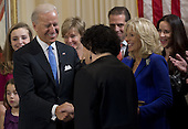 United States Vice President Joe Biden shakes hands with US Supreme Court Justice Sonia Sotomayor after taking the oath of office during the 57th Presidential Inauguration official swearing-in ceremony at the Naval Observatory on January 20, 2013 in Washington, DC..Credit: Saul Loeb / Pool via CNP