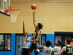 WATERBURY ,  CT-101219JS09- Holy Cross' Akili Evans puts up a floater over a Weaver High defender during the second annual Stop the Violence Basketball Tournament held Saturday at the North End Rec Center in Waterbury. The tournament was started by former Sacred Heart High School basketball star Mustapha Heron. <br />  Jim Shannon Republican-American