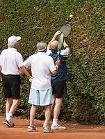 2013,August 21,Netherlands, Amstelveen,  TV de Kegel, Tennis, NVK 2013, National Veterans Tennis Championships,   getting the ball out of the bush<br /> Photo: Henk Koster