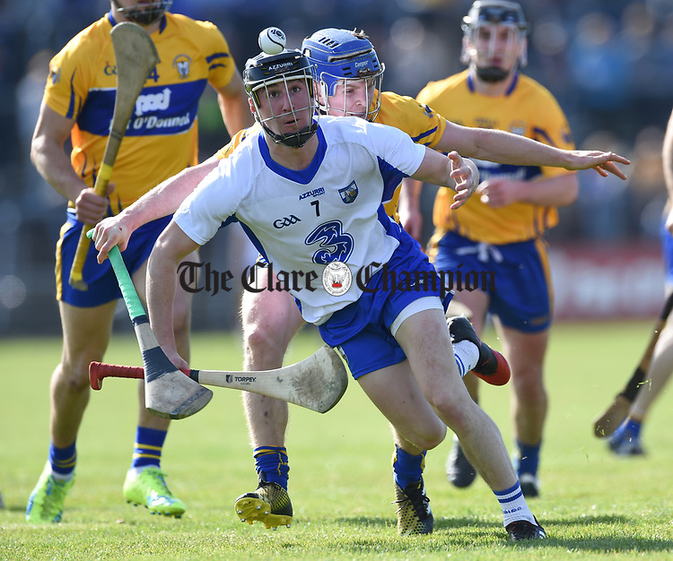 Conor Gleeson of Waterford  in action against Podge Collins of Clare during their National League game at Cusack Park. Photograph by John Kelly.