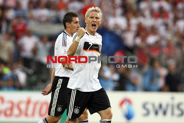 UEFA Euro 2008 Semi-Finals Match 29 Basel - St. Jakob-Park. Deutschland ( GER ) - TŁrkei ( TUR ). <br /> TorschŁtze Bastian Schweinsteiger ( Germany / Mittelfeldspieler / Midfielder / Bayern Muenchen #07 ) (r) feiert seinen Treffer zum 1:1 Ausgleich mit geballter Faust.<br /> Foto &copy; nph (  nordphoto  )