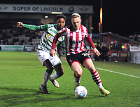 Lincoln City's Danny Rowe vies for possession with Yeovil Town's Rhys Browne<br /> <br /> Photographer Andrew Vaughan/CameraSport<br /> <br /> The EFL Sky Bet League Two - Lincoln City v Yeovil Town - Friday 8th March 2019 - Sincil Bank - Lincoln<br /> <br /> World Copyright © 2019 CameraSport. All rights reserved. 43 Linden Ave. Countesthorpe. Leicester. England. LE8 5PG - Tel: +44 (0) 116 277 4147 - admin@camerasport.com - www.camerasport.com