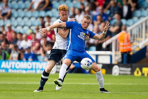 18.07.2015.  Peterborough, Engand. Pre Season Friendly Peterborough United versus Tottenham Hotspur. Marcus Maddison (Peterborough United) holds off Connor Ogilvie (Tottenham Hotspur).