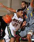 SPEARFISH, S.D. -- NOVEMBER 16, 2013 -- Julian Holliday #20 of Black Hills State drives into Jonathan Mesghna #21 of Montana State - Billings during their game Saturday at the Donald E. Young Center in Spearfish, S.D. (Photo by Dick Carlson/Inertia)