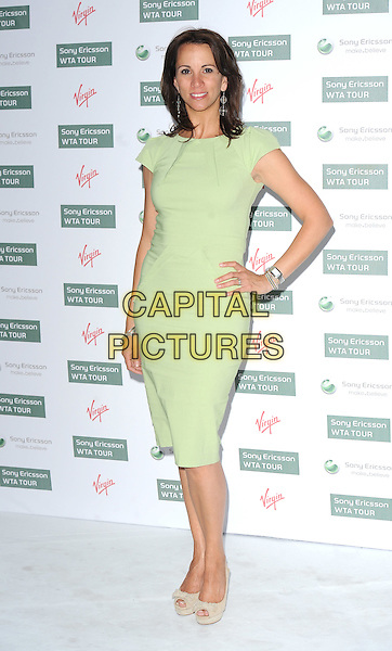 ANDREA McLEAN.The WTA Pre-Wimbledon Party, The Roof Gardens, Kensington, London, USA..June 17th, 2010.full length green dress mint hand on hip peep toe shoes beige bows platform.CAP/BEL.©Tom Belcher/Capital Pictures.