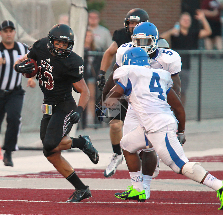 Lindenwood-Belleville WR Dylan Bradley (13) zig-zags to evade two would-be Culver-Stockton tacklers, Desmond Phillips (4) and Tyrique Gordon (5) in the first quarter.