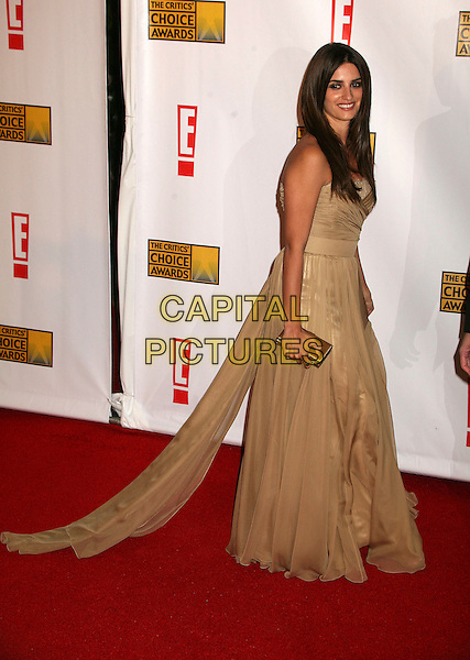 PENELOPE CRUZ.At The 12th Annual Broadcast Film Critics Choice Awards held at The Santa Monica Civic Auditorium in Santa Monica, California, LA, USA, January 12th 2007. .full length gold dress.CAP/ADM/BP.©Byron Purvis/AdMedia/Capital Pictures.