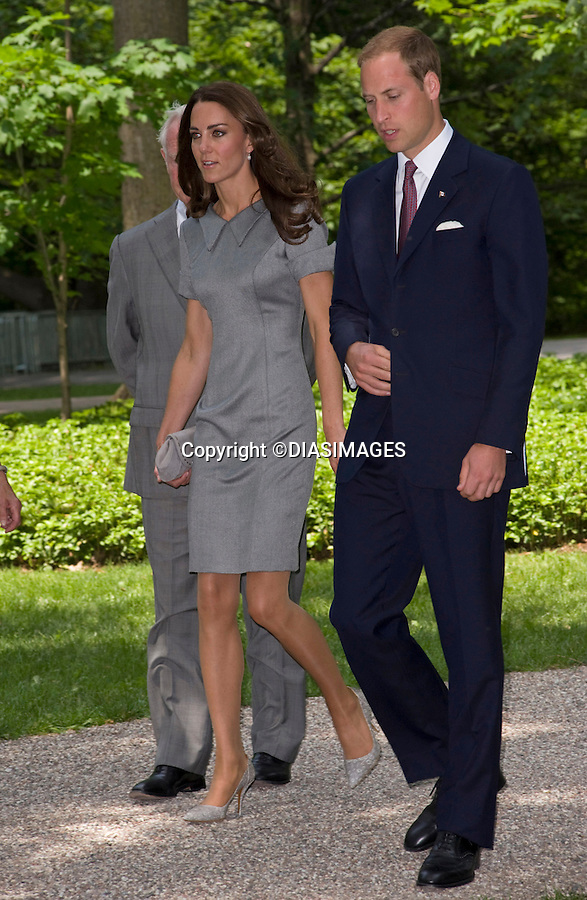 """WILLIAM & KATE TREE PLANTING.throw spades of earth on to a 2-year-old tree dedicated to their visit, inthe garden of the Governor General's residence, Rideau Hall, Ottawa_01/07/2011.Mandatory Credit Photo: ©DIAS-DIASIMAGES..**ALL FEES PAYABLE TO: """"NEWSPIX INTERNATIONAL""""**..IMMEDIATE CONFIRMATION OF USAGE REQUIRED:.DiasImages, 31a Chinnery Hill, Bishop's Stortford, ENGLAND CM23 3PS.Tel:+441279 324672  ; Fax: +441279656877.Mobile:  07775681153.e-mail: info@newspixinternational.co.uk"""