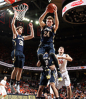 Notre Dame guard/forward Pat Connaughton (24) grabs a rebound during the game Saturday, February 22, 2014,  in Charlottesville, VA. Virginia won 70-49.