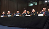 From left to right: Federal Bureau of Investigation (FBI) Director Christopher Wray,  Central Intelligence Agency (CIA) Director Mike Pompeo, Director of National Intelligence (DNI) Dan Coats, Defense Intelligence Agency (DIA) Director Lieutenant General Robert P. Ashley, Jr., United States Army, National Security Agency (NSA) Director Admiral Michael S. Rogers, United States Navy, and National Geospatial-Intelligence Agency (NGA) Director Robert Cardillo, appear together as they testify before the United States Senate Committee on Intelligence during a hearing to examine worldwide threats on Capitol Hill in Washington, DC on Tuesday, February 13, 2018<br /> Credit: Ron Sachs / CNP