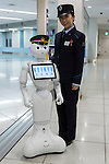 SoftBank's humanoid robot Pepper poses with a coworker on its first day as a new member of staff for the Keikyu Line railway at Haneda International Terminal station on November 28, 2015, Tokyo, Japan. Pepper is programmed to interact with Japanese and foreign commuters and to introduce Keiyu Line information. (Photo by Rodrigo Reyes Marin/AFLO)