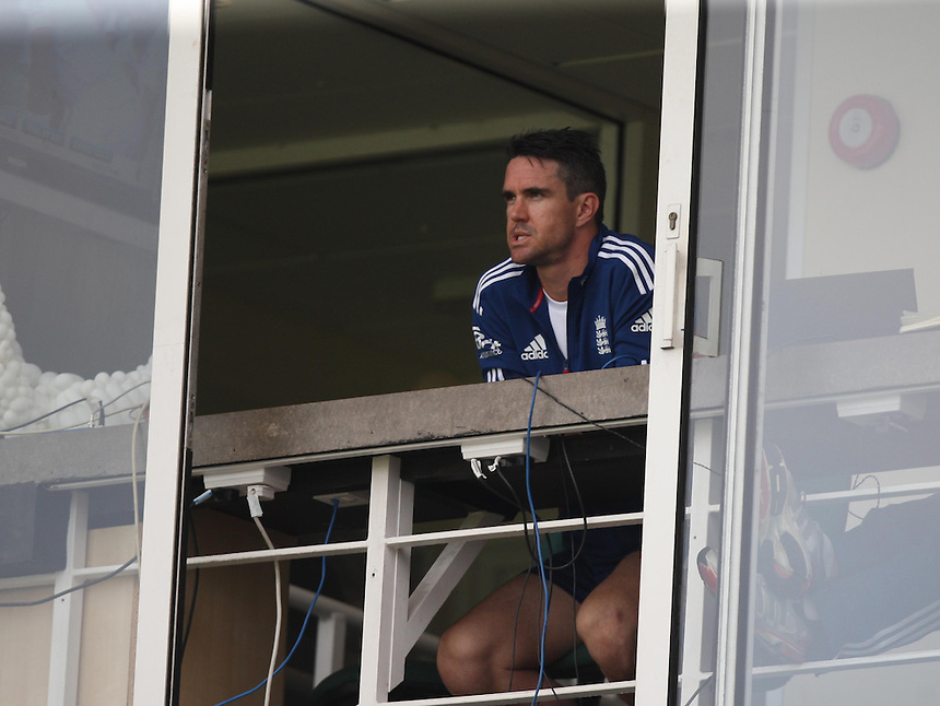 England's Kevin Pietersen  watching from the window<br /> <br /> Photo by Kieran Galvin / CameraSport<br /> <br /> International Cricket - Fifth Investec Ashes Test Match - England v Australia - Day 5 - Thursday 25th August 2013 - The Kia Oval - London<br /> <br /> &copy; CameraSport - 43 Linden Ave. Countesthorpe. Leicester. England. LE8 5PG - Tel: +44 (0) 116 277 4147 - admin@camerasport.com - www.camerasport.com