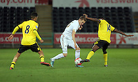 Pictured: Ryan Hedges of Swansea (C) against Khalid Abdo (L) and Corey Blackett-Tayor (R) of Aston Villa Monday 25 April 2016<br /> Re: Play Off semi final, Swansea City AFC U21 v Aston Villa FC U21 at the Liberty Stadium, Swansea, UK
