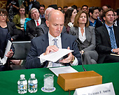 """Richard F. Smith, former Chairman and Chief Executive Officer, Equifax, Inc. looks over his notes prior to giving testimony before the United States Senate Committee on Banking, Housing, and Urban Affairs as they conduct a hearing entitled, """"An Examination of the Equifax Cybersecurity Breach"""" on Capitol Hill in Washington, DC on Tuesday, October 3, 2017. <br /> Credit: Ron Sachs / CNP"""