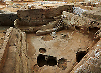 Building 321. Empty burial pit in the floor of the Neolithic remains of mud brick house. In the top right is a darker area which was the midden or refuse pile from the house. North ecavation area, Catalyhoyuk Archaeological Site, Çumra, Konya, Turkey