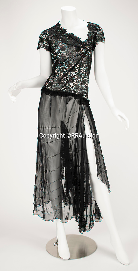 """BNPS.co.uk (01202 558833)<br /> Pic: RRAuction/BNPS<br /> <br /> Pictured: """"Highland Rape"""" Black Lace Short Asymmetrical Dress AW 1995 has an estimate of $25,000<br /> <br /> A vast archive of items relating to British fashion designer Alexander McQueen have emerged for sale for over £1m.<br /> <br /> The enormous collection has been amassed by one of his personal friends -Ruti Danan who worked worked for the late icon for two years between 1994 and 1996.<br /> <br /> During that period she amassed a treasure trove of items including items of clothing, behind-the-scene photographs and sketches of new designs.<br /> <br /> She has kept the collection for over two decades but has now decided the time is right to part with it for the first time.<br /> <br /> There are an incredible 74 lots set to go under the hammer at RR Auction of Boston, Massachusetts."""