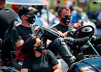 Jul 10, 2020; Clermont, Indiana, USA; NHRA pro stock motorcycle rider Angelle Sampey (bottom) and teammates  Andrew Hines (left) and Eddie Krawiec wear face masks during testing for the Lucas Oil Nationals at Lucas Oil Raceway. This will be the first race back for NHRA since the COVID-19 pandemic. Mandatory Credit: Mark J. Rebilas-USA TODAY Sports
