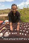 Chile, Easter Island: Crafts sellers create wood story boards, shell necklaces, fishhook pendants from bone, wood and stone carvings of moai..Photo #: ch352-33645.Photo copyright Lee Foster www.fostertravel.com lee@fostertravel.com 510-549-2202