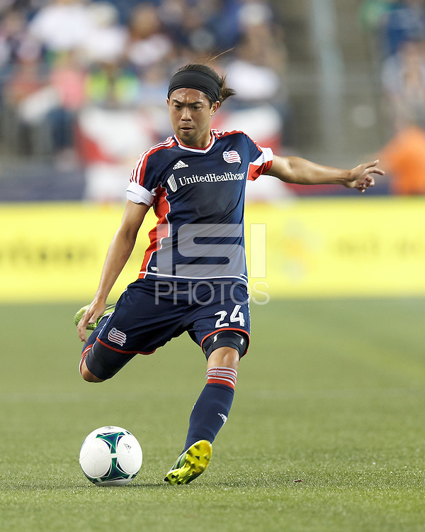 New England Revolution midfielder Lee Nguyen (24) passes the ball.  In a Major League Soccer (MLS) match, the New England Revolution (blue) defeated Chicago Fire (red), 2-0, at Gillette Stadium on August 17, 2013.