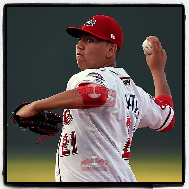 Starting pitcher Bryan Mata (21) of the Greenville Drive delivers a pitch in Game 2 of the South Atlantic League Southern Division Playoff against the Charleston RiverDogs on Friday, September 8, 2017, at Fluor Field at the West End in Greenville, South Carolina. Charleston won, 2-1, and the series is tied at one game each. (Tom Priddy/Four Seam Images)
