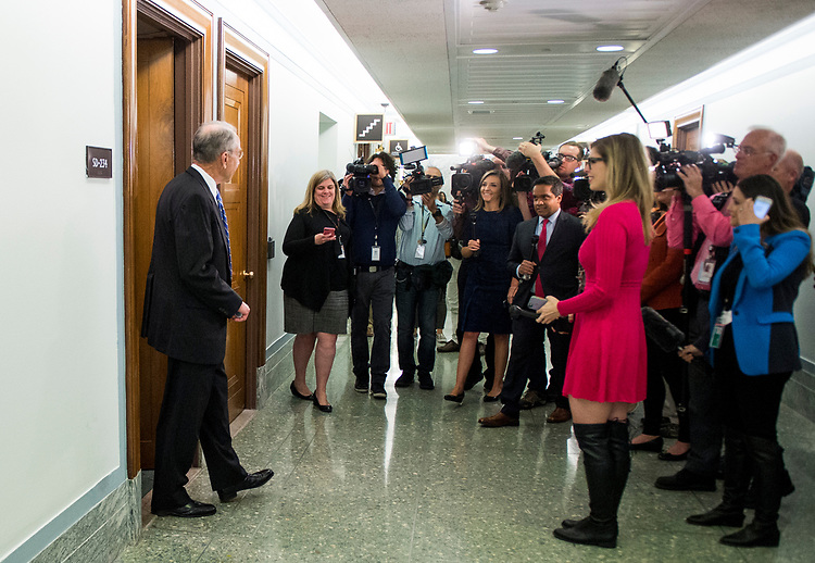 UNITED STATES - MAY 10: Judiciary chairman Sen. Chuck Grassley, R-Iowa, is greeted by cameras as he leaves the Senate Judiciary Committee hearing room on Wednesday, May 10, 2017. (Photo By Bill Clark/CQ Roll Call)