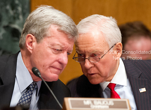 United States Senator Max Baucus (Democrat of Montana), Chairman, U.S. Senate Finance Committee and Ranking Member U.S. Senator Orrin Hatch (Republican of Utah) discuss the testimony U.S. Secretary of Health and Human Services (HHS) Kathleen Sebelius during a hearing on the agency's FY 2013 budget proposal on Capitol Hill in Washington, D.C. on Wednesday, February 15, 2012..Credit: Ron Sachs / CNP