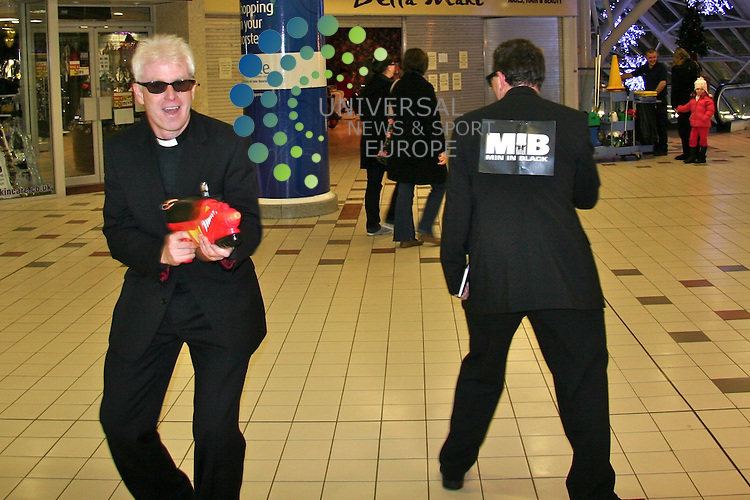 "It's not your typical mission, but two clergymen have taken to the streets of an Ayrshire town armed with ""alien thought guns"", black books, ""memory wiping neuralyzers"" and sheer charm in an attempt to rescue the Christmas message from commercialisation. ""Ministers in Black"", or ""Min in Black"", are made up of Irvine Church of Scotland minister Reverend Neil Urquhart  (left) and Roman Catholic colleague Father Willie Boyd. They want to challenge the ridiculous myths which surround the festive season, and for people to focus more on the nativity story. The duo's inaugural outing has been posted on Youtube, and shows them explaining to local shoppers in the town's Rivergate Mall the connections Jesus has to Christmas trees, crackers and even Santa. Mr Urquhart, minister at Fullarton Parish Church, said: ""Now that another X-Factor series is over we wanted to ask about the real ""X"" factor of Christmas. ""Many shorten ""Happy Christmas"" to ""Happy Xmas"" to save time, and some send ""Seasons Greetings"" in an attempt to be politically correct. ""Min in Black wanted to expose and explode all thoughts alien to the true meaning of Christmas. ""We want to rescue people from the ridiculous and connect them with Jesus, the real reason for the season.""..Picture Universal News And Sport (Europe) 21 December  2010 All pictures must be credited to www.unpixs.com. (0ffice) 0844 884 51 22  ."