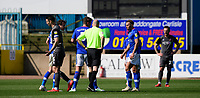 Lincoln City's Jason Shackell, left, leaves the pitch after he was shown a red card by referee Lee Mason<br /> <br /> Photographer Chris Vaughan/CameraSport<br /> <br /> The EFL Sky Bet League Two - Carlisle United v Lincoln City - Friday 19th April 2019 - Brunton Park - Carlisle<br /> <br /> World Copyright © 2019 CameraSport. All rights reserved. 43 Linden Ave. Countesthorpe. Leicester. England. LE8 5PG - Tel: +44 (0) 116 277 4147 - admin@camerasport.com - www.camerasport.com