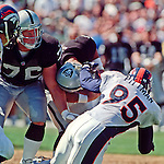 Oakland Raiders vs. Denver Broncos at Oakland Alameda County Coliseum Sunday, September 17, 2000.  Broncos beat Raiders  33-24.  Denver Broncos defensive end Kavika Pittman (95) sacks Oakland Raiders quarterback Rich Gannon (12).