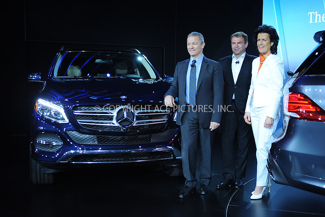 WWW.ACEPIXS.COM<br /> April 1, 2015 New York City<br /> <br /> Stephen Cannon, chief executive officer of Mercedes-Benz USA, and Annette Winkler, head of Daimer AG's smart brand, unveil the Mercedes-Benz GLE sport-utility vehicle and the revised smart fortwo city car at the New York International Auto Show at the Jacob K. Javits Convention Center on  April 1, 2015 in New York City.<br /> <br /> Please byline: Kristin Callahan/AcePictures<br /> <br /> ACEPIXS.COM<br /> <br /> Tel: (646) 769 0430<br /> e-mail: info@acepixs.com<br /> web: http://www.acepixs.com