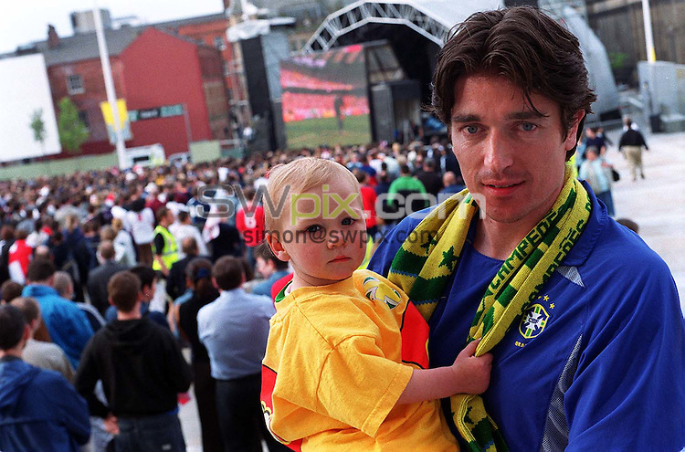 Pix: Ben Duffy/SWpix.com. Soccer, World Cup. England v Brazil. 21/06/2002..COPYWRIGHT PICTURE>>SIMON WILKINSON>>01943 436649>>..Futebol de Salao, Simon Clifford with his daughter Mary watches the game in Millenium Square outside the Civic Centre in Leeds