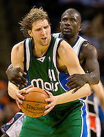 Dallas Mavericks forward Dirk Nowitzki against Charlotte Bobcats Jason Richardson during an NBA basketball game Time Warner Cable Arena in Charlotte, NC.