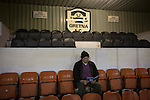 Gretna 0 Dalbeattie Star 0, 11/03/2016. Raydale Park, Lowland League. A 'groundhopper'  reading his match programme in the main stand at Raydale Park, before Gretna take on Dalbeattie Star in a Scottish Lowland League fixture which ended 0-0. The match was one of six arranged by the league and GroundhopUK over the weekend to accommodate groundhoppers, fans who attempt to visit as many football venues as possible. Around 100 fans in two coaches from England participated in the 2016 Lowland League Groundhop and they were joined by other individuals from across the UK which helped boost crowds at the six featured matches. Photo by Colin McPherson.