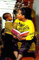 Mother age 38 discussing story with 6 year old son in their house.  St Paul Minnesota USA