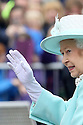 Britain's Queen Elizabeth II and the Duke of Edinburgh  (unseen) waves to local people of Coleraine, as they finish their three day tour of Northern Ireland, Wednesday June 25, 2014. Photo/Paul McErlane