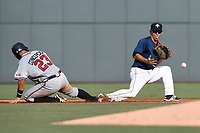 Shortstop Andres Gimenez (13) of the Columbia Fireflies gets the throw late as Anthony Concepcion (23) of the Rome Braves slides in safely with a stolen base on Sunday, July 2, 2017, at Spirit Communications Park in Columbia, South Carolina. Columbia won, 3-2. (Tom Priddy/Four Seam Images)
