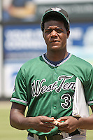 Pitcher Michael Pineda of the West Tenn Diamond Jaxx walking to the dugout with a notebook before a game against the Carolina Mudcats on May 30, 2010 in Zebulon, NC.