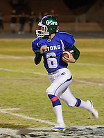 Oct. 15, 2009. Henderson, NV: Senior kicker Nolan Kohorst fakes a punt and takes off for a first down against the Basic Wolves. Kohorst went on to play for the UNLV Rebels where he led his team with 53 total points during his freshman year.